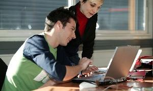 Photo of employee working with job developer
