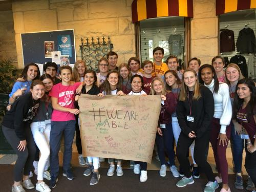 Students at a high school in the Chicago area taking the We Are Able pledge