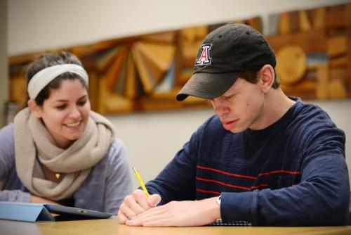 Two students doing classwork